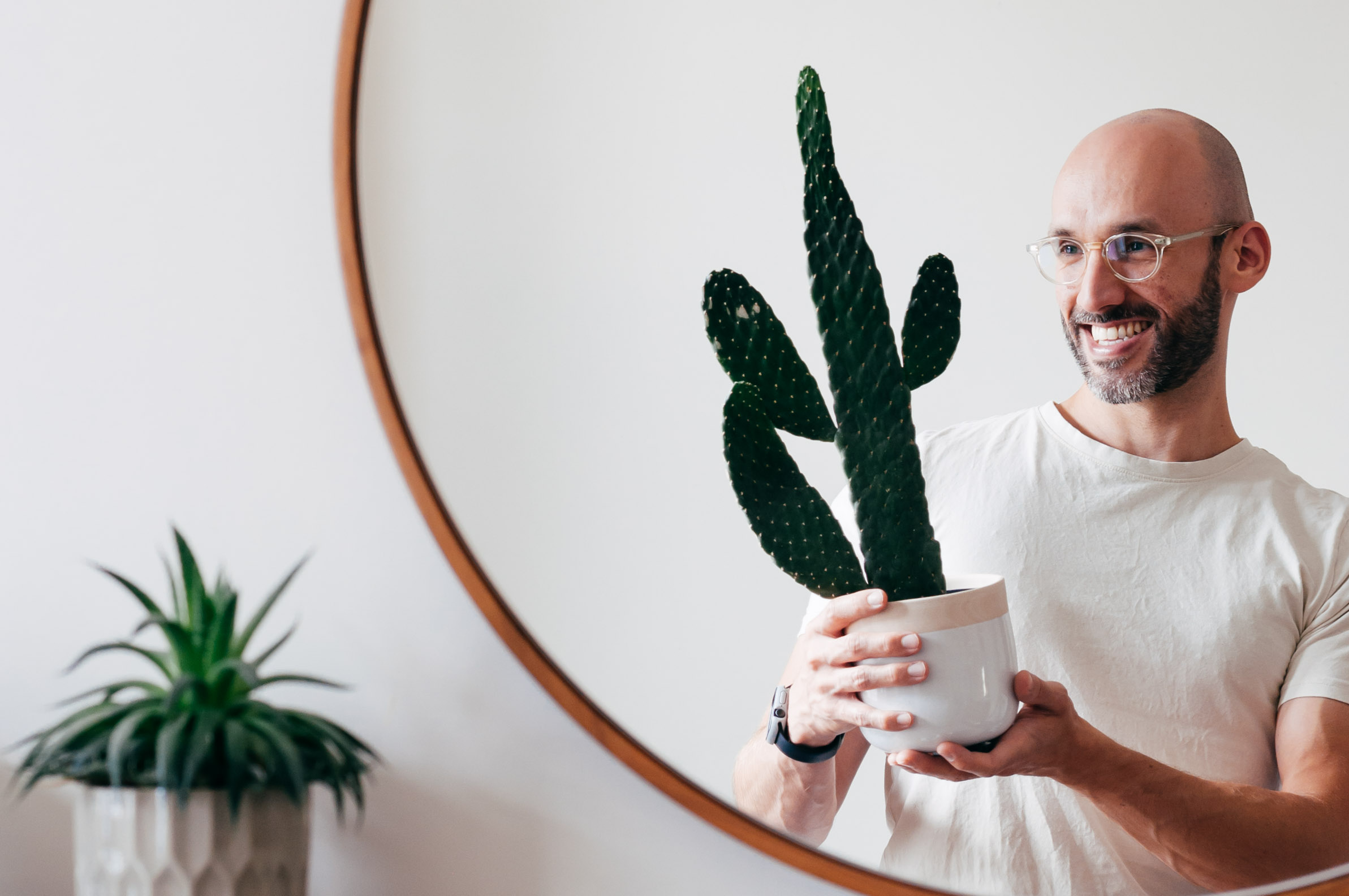 Juan Sandiego holding a potted cactus